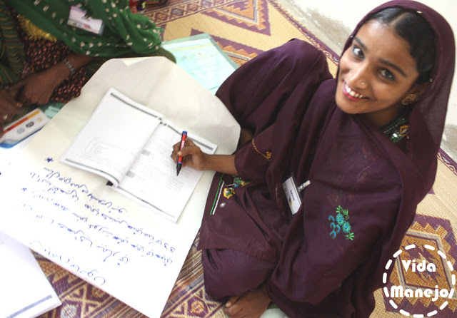 A young trainee learning to read and write